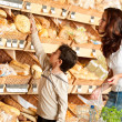 Grocery store shopping - Woman and child choosing bread — Stock Photo #4684264
