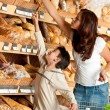Grocery store shopping - Womwith child — Stock Photo #4684268