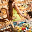 Stock Photo: Grocery store shopping - Red hair woman with child