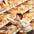 Grocery store shopping - Boy buying bread — Stock Photo
