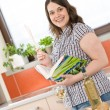 Cook - plus size woman prepare fish with white wine - Stok fotoğraf