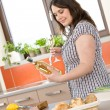 Cook - plus size woman prepare fish with white wine - Lizenzfreies Foto