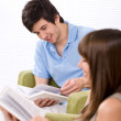 Student - two teenager reading book home — Stock Photo