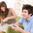 Royalty-Free Stock Photo: Student - happy teenagers playing video game with control pad