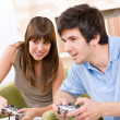 Student - happy teenagers playing video game — Stock Photo