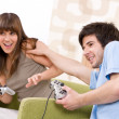 Stock Photo: Student - happy teenagers playing video game