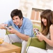 Stock Photo: Student - happy teenagers playing video game having fun