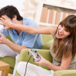 Student - happy teenagers playing video game — Stock Photo #4684479