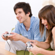 Student - happy teenagers playing video game — Stock Photo #4684480