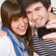 Royalty-Free Stock Photo: Students - happy teenage couple taking photo with camera