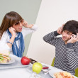 Stock Photo: Student cafeteri- teenage couple having fun