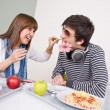 Student cafeteria - teenage couple having fun - Stock Photo