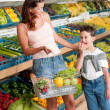Grocery store shopping - Woman with child - Stok fotoğraf