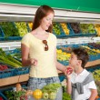 Grocery store shopping - Red hair woman with child - ストック写真