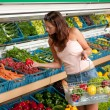 Grocery store shopping - Young woman buying vegetable — Stock Photo