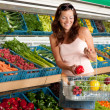 Stock Photo: Grocery store shopping - Smiling womwith vegetable