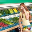 Stock Photo: Grocery store shopping - Red hair woman in a supermarket