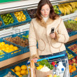Grocery store shopping - Woman in winter outfit — Stock Photo