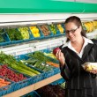 Grocery store shopping - Business woman holding apple — Stock Photo