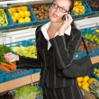 Grocery store shopping - Business woman with mobile phone — Stock Photo #4684567