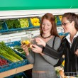 Grocery store shopping - Two business women - Photo