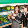 Grocery store shopping - Two business women - Stock Photo