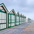 Long row of wooden beach cabins — Stock Photo