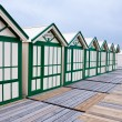 Wide angle view of wooden beach huts - Stock Photo