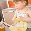 Child baking - little girl kneading dough — Stock Photo #4684640