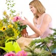Gardening - Happy woman holding flower pot — Stock Photo