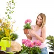 Gardening - Happy woman holding flower pot — Foto Stock
