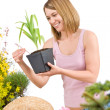 Gardening - Smiling woman holding flower pot — Stock Photo