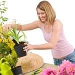 Gardening - Smiling woman holding flower pot — Stock Photo #4684656