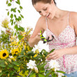 Gardening - woman cutting flower with pruning shears — Стоковая фотография