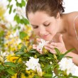 Gardening - Woman smelling blossom flower — Stock Photo