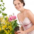 Gardening - woman holding flower pot — Stockfoto
