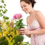 Gardening - smiling woman holding flower pot — Stock Photo #4684696