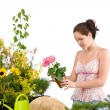 Gardening - smiling woman holding flower pot — Stock Photo #4684697