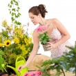 Gardening - smiling woman holding flower pot — Foto de Stock