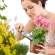 Gardening - woman holding flower pot and shovel — Stock Photo