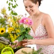 Gardening - woman holding flower pot and shovel - Stock Photo