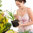 Gardening - woman holding flower pot — Stock Photo