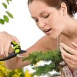 Gardening - woman cutting tree with pruning shears — Stock Photo