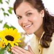 Portrait of happy woman with sunflower — Stock Photo #4684746