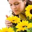 Portrait of beautiful woman with sunflowers — Стоковая фотография