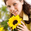 Portrait of beautiful woman with sunflowers — Stock Photo #4684760