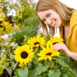Gardening - portrait of woman with sunflowers — Stock Photo
