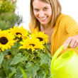 Gardening - woman pouring flowers — Stock Photo
