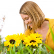 Gardening - portrait of smiling woman with sunflowers — Stock Photo #4684879