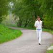 Stock Photo: Jogging - sportive womrunning on road in nature